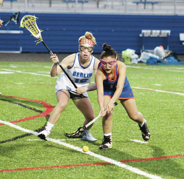 Olentangy Berlin's Dacey Redman, left, and Olentangy Orange's Raneem Ali battle for a ground ball during the first half of Thursday's non-league showdown in Delaware.