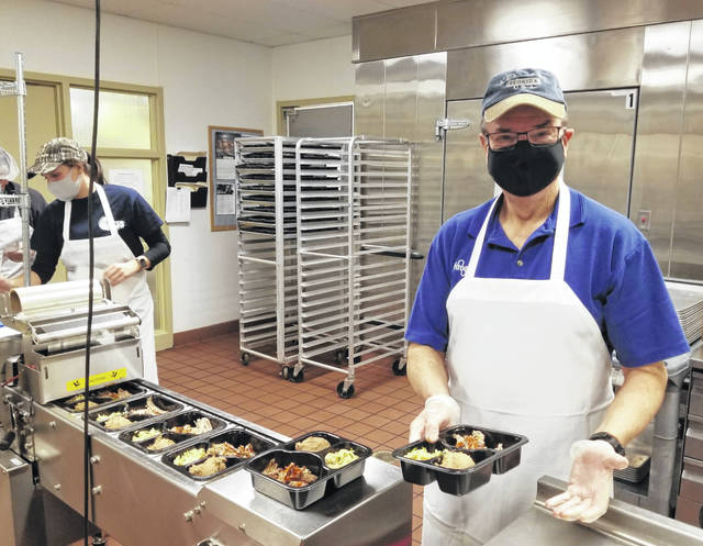 Randy Smith helps prep meals for SourcePoint's Meals on Wheels program.