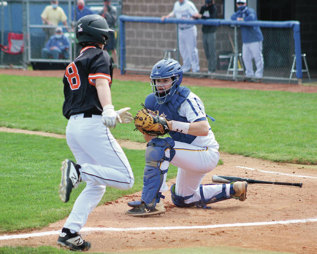 Olentangy's Eric Efland stares down Hayes' Bryden Decaminada before a play at the plate Saturday in Lewis Center.