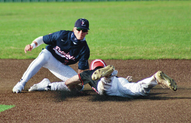 Olentangy Liberty's Mason Onate tags out a Westerville South baserunner during Tuesday's non-league showdown in Powell.