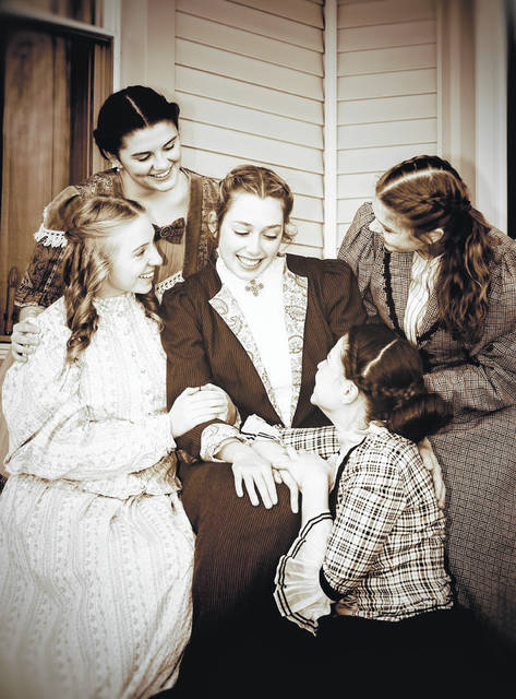 """Meredith Keller, who plays Marmee March in the upcoming performance of """"Little Women: The Broadway Musical,"""" sits surrounded by her castmates and """"children:"""" Audrey Young, who plays Beth; Julia Waltz, who plays Meg; Rachel White, who plays Jo; and Izzy Crissinger, who plays Amy."""