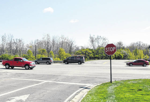 Vehicles pass through the U.S. Route 23 and Hull Drive intersection Thursday afternoon.