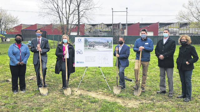 Pictured at the site of the future home build are (left to right) Brandi Jackson, TAG Community Living, Inc. board member; Dr. John Kellogg, The Alpha Group board chair; Liz Owens, The Alpha Group CEO & TAG executive director; Rick Rano, TAG board chair; Todd Miller, executive director of Habitat For Humanity Delaware & Union Counties; Phil Eley, Habitat For Humanity board chair; and Cindy Ray, Habitat For Humanity board member.