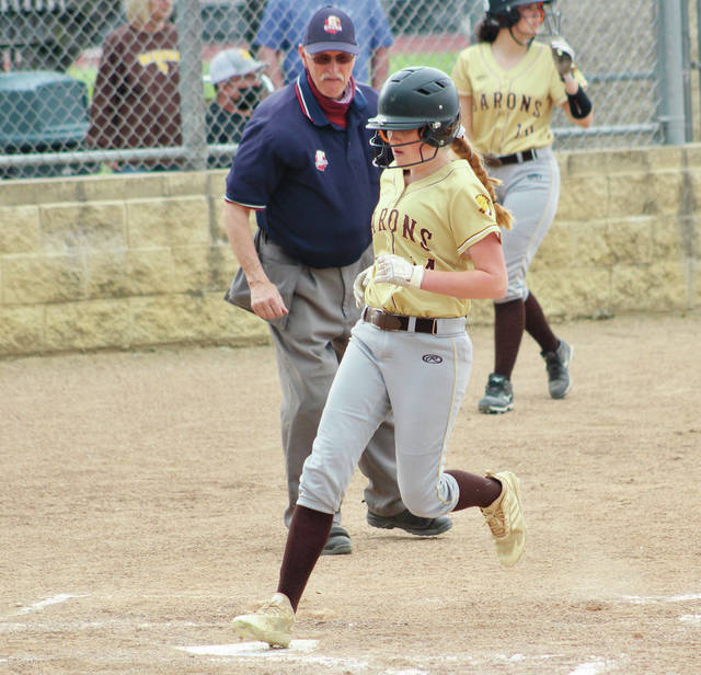 Buckeye Valley's Courtney Beneke scores a run during Monday's league opener against visiting Wellington.
