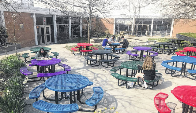 Seniors at Hayes High School eat lunch in the courtyard, which was recently converted to a space for seniors. Principal Ric Stranges wanted seniors to have a space all their own and purchased 20 tables for the courtyard.