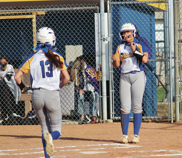Olentangy's Jaelyn Peterson cheers on Brynn Kibler (13) as she trots toward home plate after launching a solo home run during Friday's non-league showdown against visiting Reynoldsburg.