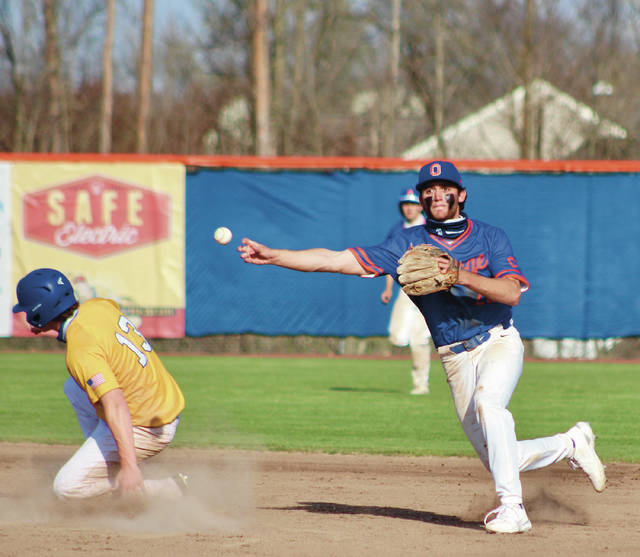 Olentangy Orange shortstop Matthew Wolfe fires to first base to try and turn a double play during Tuesday's non-league showdown against visiting Olentangy.