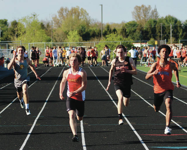 Buckeye Valley's Anthony Hughes, Big Walnut's Shane White, Delaware Hayes' Logan Hummel and Olentangy Orange's Jordan Rudolph, from left to right, compete in the 100-meter dash during Monday's quad meet in Lewis Center. White won the event with a personal-best effort of 11.29 seconds.