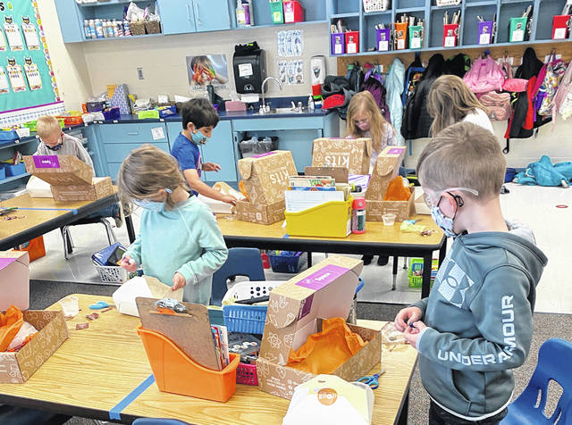 Kindergarten students at Conger Elementary School assemble COSI Science Kits. Students are still required to wear masks while at school.
