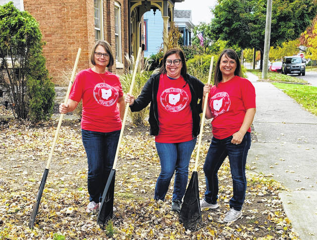 Pictured, left to right, are Community Engagement coordinators Colleen Dennis and Elaine Miller, along with Program Director Suzanne Pingry, are all smiles while raking leaves during Make A Difference Day Delaware County.