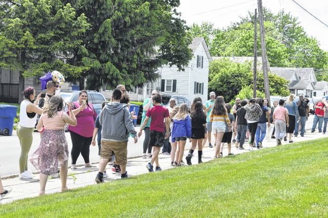 """Fifth graders at Woodward get cheered on by their families Thursday afternoon during their """"clapout."""" Thursday was the last day of school for Cohort B and DCS Online Academy students. Cohort A students concluded their school year on Tuesday."""