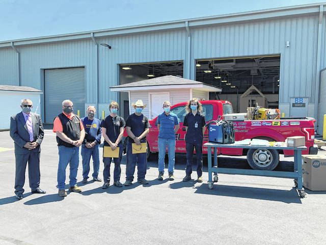 Members of the Sunbury-Galena Rotary Club met with DACC welding seniors to present them with gifts last week outside the DACC's consolidated campus. Pictured, left-to-right, are Dave Knowlton, foundation chair of the Sunbury-Galena Rotary; Tim Kendall, division manager at DeLille Oxygen; Bruce Denton, Sunbury-Galena rotarian; Garison Frisch, welding senior from Big Walnut High School; Blaize Foster, welding senior from Big Walnut High School; Al Blythe, president-elect of the Sunbury-Galena Rotary; and Kenneth Knight, a welding senior from Delaware Hayes High School.