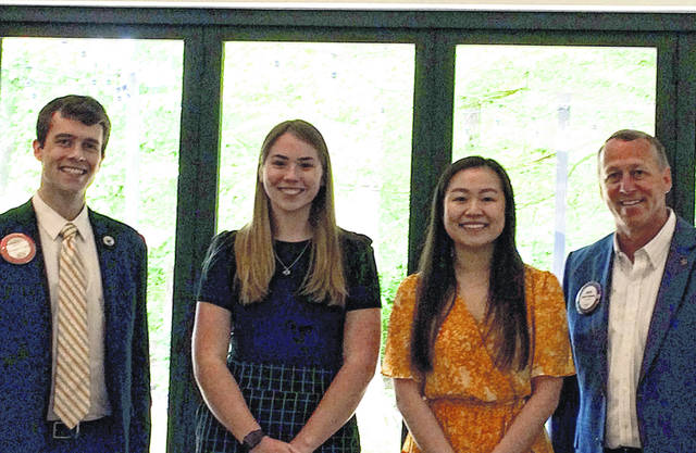 Pictured, left to right, are scholarship committee member Michael Ringle, Mackenzie Collett, Lisa Choe and Rotary President Scott Cubberly.