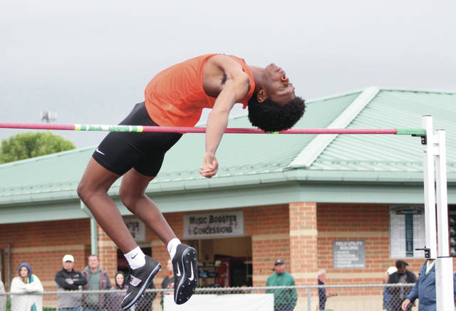 Olentangy Orange's Joel Addo competes in the high jump at Friday's Division I regional championship meet at Pickerington North. Addo finished third in the event to punch a ticket to the upcoming state showcase.