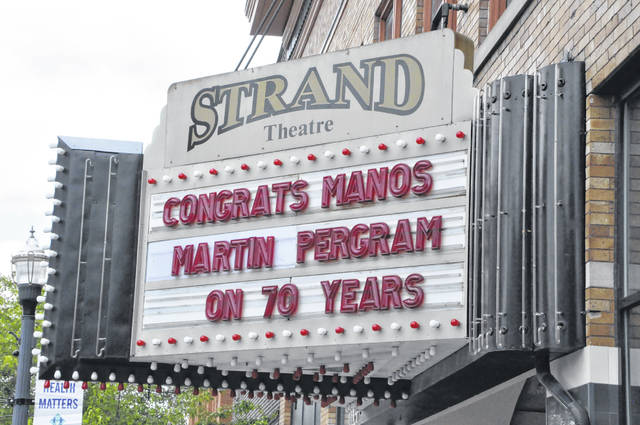 The Strand Theatre's marquee highlights the 70th anniversary of Manos, Martin, and Pergram Co., LPA. The law firm was started by Peter Manos in Delaware back in 1951.