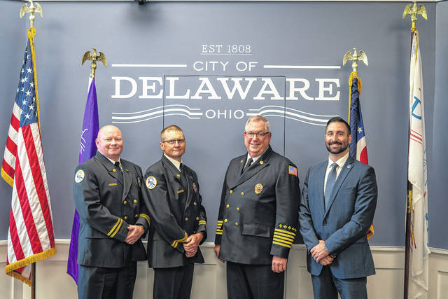 Pictured, left to right, are Delaware Fire Department Capt. Jeremie Barr, Capt. John Hall, Chief John Donahue and Assistant City Manager Kyle Kridler.