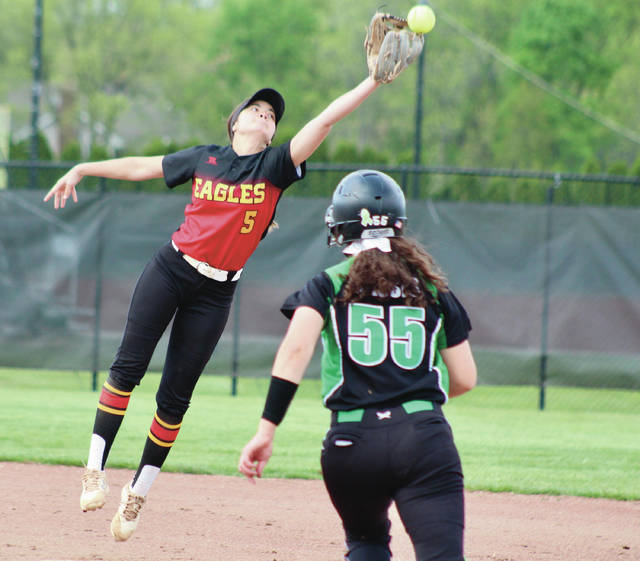 Big Walnut shortstop Arielle Brown (5) reaches for a high throw to second during the first inning of Monday's Division I sectional semifinal against host Dublin Coffman.