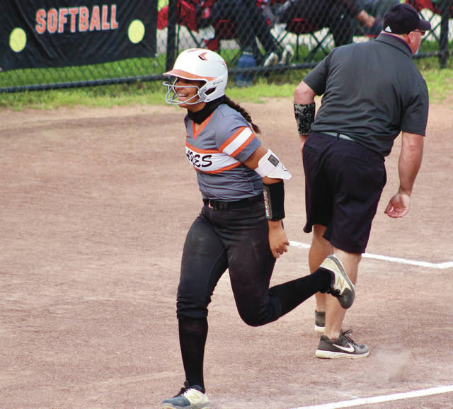 Delaware Hayes' Myaih Cloud is all smiles on her way toward home plate after hitting a two-run homer in the bottom of the fifth inning of Monday's Division I district semifinal against visiting Newark.