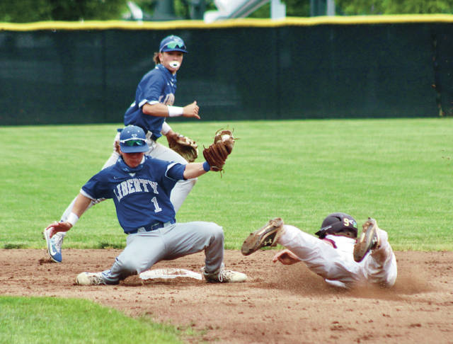 Olentangy Liberty's Michael Tuttle (1) gloves a short-hop as New Albany's Brock Tibbitts (9) slides safely into second base for a steal during Wednesday's Division I district championship in New Albany.
