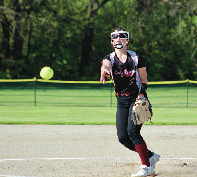 Delaware Christian's Krista Haskins fires a pitch toward home plate during Thursday's Division IV sectional final against visiting Fisher Catholic.