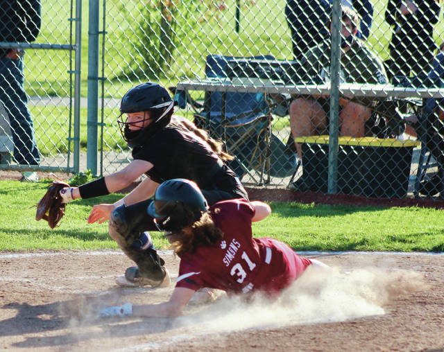 Newark's Paige Simons (31) slides safely into home ahead of the tag from Olentangy Liberty catcher Ashley Chevalier during Wednesday's Division I sectional final in Powell.