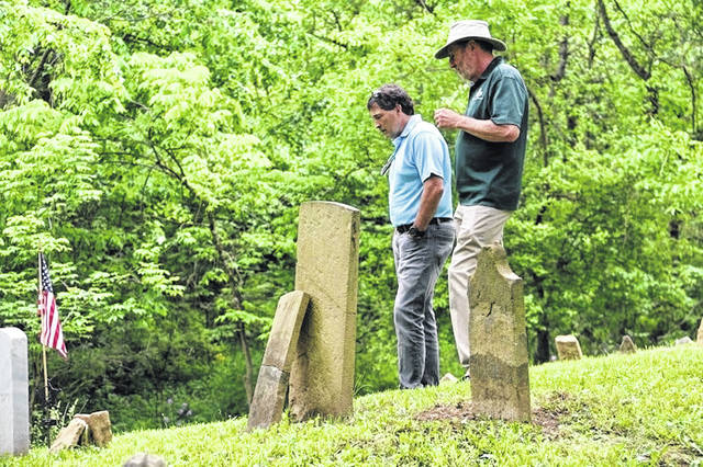 Congressman Troy Balderson (OH-12), left, tours the Stratford Cemetery in Delaware.