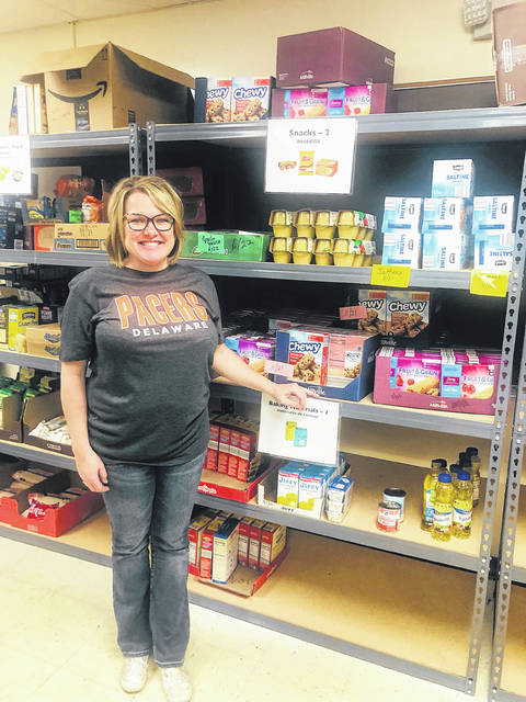 Carrie Hunt, the new program coordinator at Delaware City School's Family Resource Center, stands inside the Pacer Pantry, which provides food and other items to families within the district.