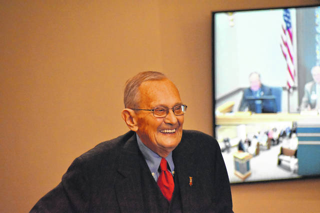 Former Delaware County Common Pleas Judge Henry E. Shaw Jr. laughs while telling a story Thursday morning after learning Delaware County commissioners were dedicating their hearing room, which used to serve as his courtroom, in his honor.