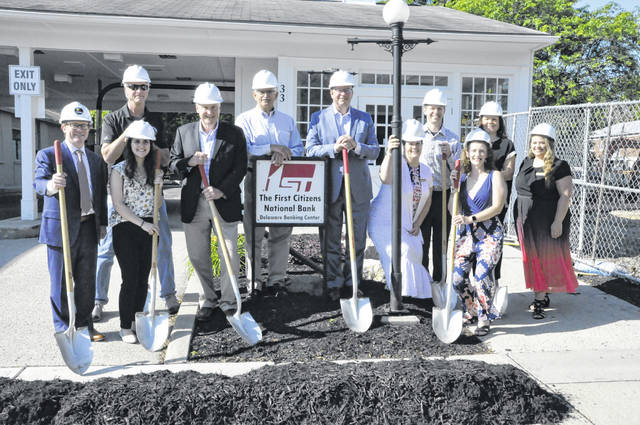 First Citizens National Bank held a groundbreaking ceremony Thursday morning at its Delaware Banking Center. Located at 33 W. William St. in downtown Delaware, the branch, which has been serving customers since April, will remain open as the building undergoes a 2,200-square-foot expansion scheduled to be completed by December. Pictured, left to right, are (front row): Zach Price and Jena Kesler of TRIAD Architects; Mark Johnson, president/CEO First Citizens National Bank; Dana Polhamus, First Citizens National Bank – Delaware Banking Center; Katie Weaver, First Citizens National Bank; (Back row): Bill Morgan, 2K General Construction; Bill Clark, First Citizens National Bank; Frank Reinhard, regional president First Citizens National Bank – Delaware Banking Center; Jevon Reile, SVP/CIO/COO First Citizens National Bank; Jenny Romich, SVP/CLO First Citizens National Bank; and Brittany Tate, First Citizens National Bank – Delaware Banking Center.