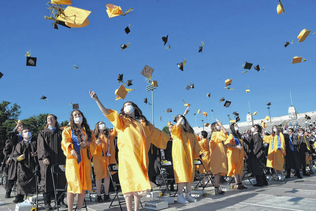 Seniors in the Buckeye Valley High School Class of 2021 throw their caps in the air as the graduation ceremony concludes Sunday at Ohio Wesleyan University's Selby Stadium.