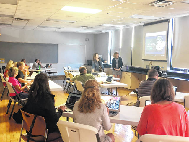 Buckeye Valley Intervention specialists Barbara Gall and Ellie Beaver give a presentation on using technology in the classroom earlier this week during the joint professional development days held by BV and Delaware City Schools.