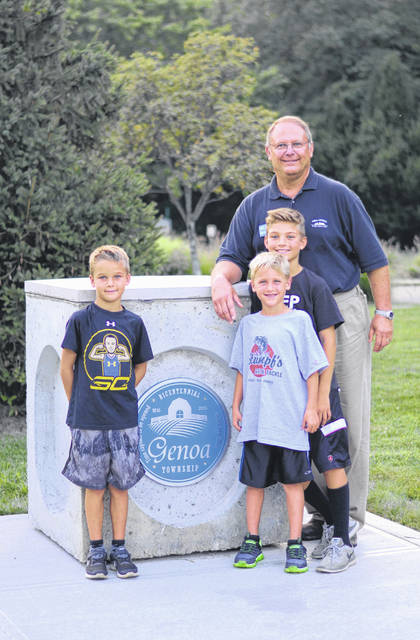Gebhardt is shown in this 2017 photo with his grandsons before a Movie Night in Genoa Township.