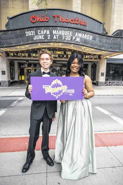 Nick Sanchez-Zarkos and Dallys Edwards hold a CAPA Marquee Awards sign outside the Ohio Theatre in Columbus.