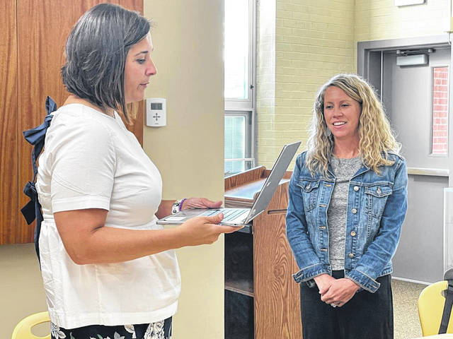 New Buckeye Valley Board of Education member Jamie Ottery, right, is given the oath of office by Treasurer Kelly Ziegler during Wednesday's board meeting.