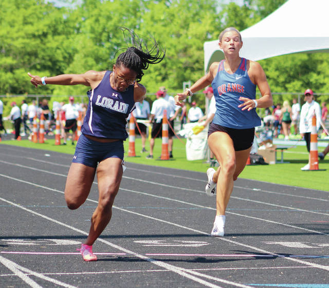 Olentangy Orange's Ava Musgrove, right, and Lorain's Mikiya Hermon compete at the Division I state track and field championship meet at Hilliard Darby.