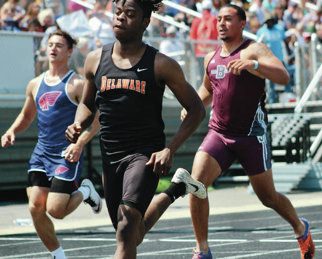 Delaware Hayes' Orion Ward, center, competes in the 100-meter dash at Friday's Division I Track and Field State Championship meet at Hilliard Darby.