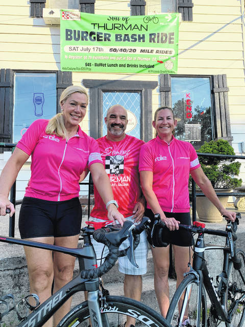 The inaugural Burger Bash Ride for the benefit of Pelotonia will take place July 17. Pictured, left to right, are co-organizer Jamie Stevens, Son of Thurman owner Chris DeVol, and co-organizer Cassie Swackhammer.