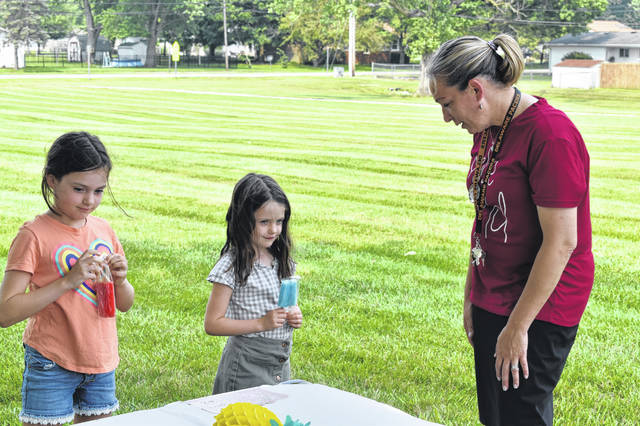 Principal Paula Vertikoff talks to Anna, a fourth grader, and Ellie, a first grader, Tuesday and asked them about the upcoming school year.
