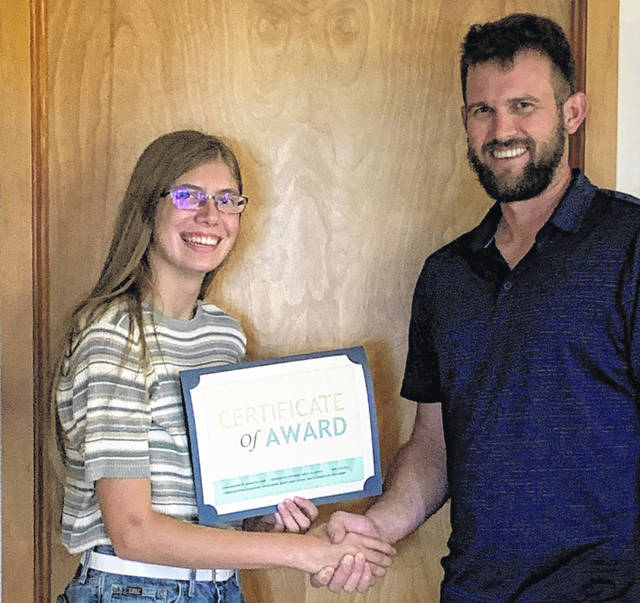 Jordan Kelleher, scholarship recipient, is congratulated by Benjamin Wenner, Delaware County Agricultural Society president.