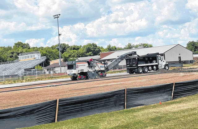 Construction crews remove the old tennis courts at Buckeye Valley High School. The Buckeye Valley Board of Education approved a proposal from Vasco Sports Contractors Wednesday to demolish the old courts and replace them with new courts.