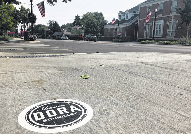 Stickers and signs mark the boundaries of Westerville's DORA.