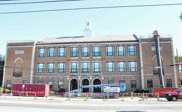 Crews work on the roof at Willis Education Center, 74 W. William St. in Delaware. Back in April, the Delaware City Schools Board of Education approved roof work on the building at a cost of $458,450.