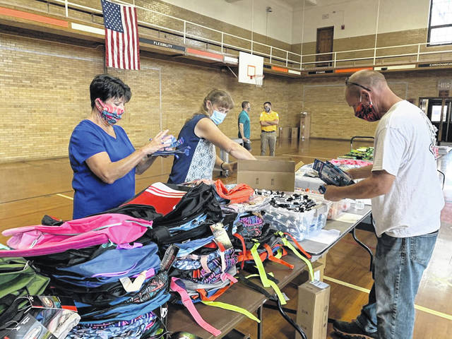 Volunteers set up backpacks and other supplies during the 2020 Supplies for Scholars event. The 2021 event will be held next week at Willis Education Center.