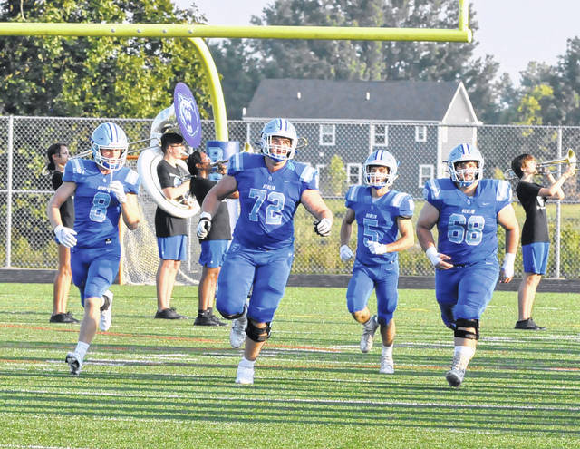 Members of the Olentangy Berlin High School football team run onto the field prior to Friday night's home opener against St. Francis DeSales.