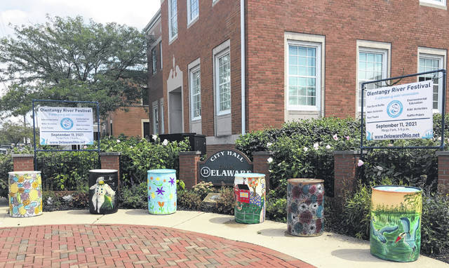 Numerous rain barrels are on display outside Delaware City Hall to help bring attention to the upcoming Olentangy River Festival.