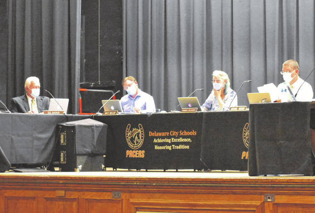The Delaware City Schools Board of Education discusses mask requirements during Monday's meeting. The board voted to unanimously approve a mask requirement for staff and students to prevent the spread of COVID-19.