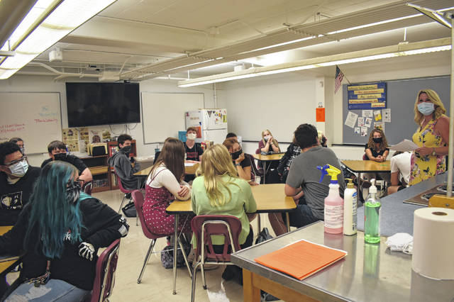 Family and Consumer Science teacher Katrina Wetherby (right) talks to Hayes High School students on their first day in her class Wednesday.