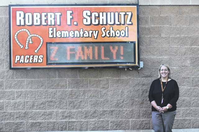 Schultz Elementary School Assistant Principal Tyra Baisden stands outside the school Friday after the first week of the 2021-2022 school year.