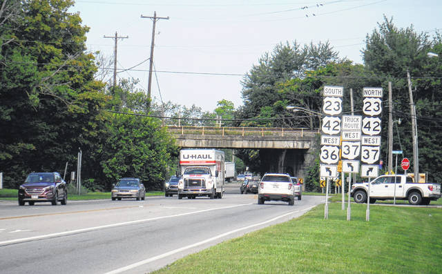 Vehicles travel through the Point (U.S. Route 36/state Route 37 intersection) Friday in Delaware.