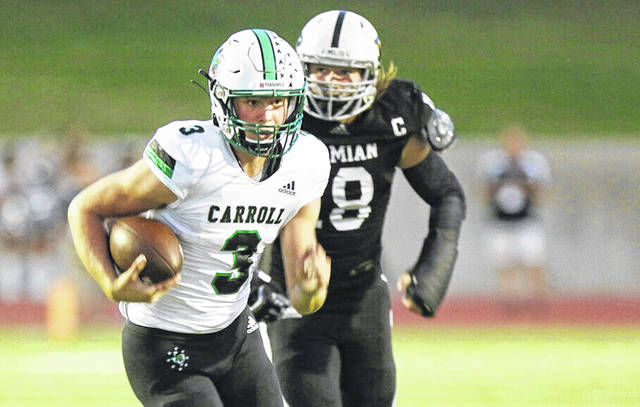 Southlake Carroll quarterback Quinn Ewers (3) runs for a first down against Permian during the first half of a high school football game in Odessa, Texas, in this Friday night Sept. 13, 2019, file photo. Quinn Ewers, considered the top quarterback prospect in the class of 2022, said he is skipping his senior year of high school in Texas and plans to enroll at Ohio State for the upcoming semester.